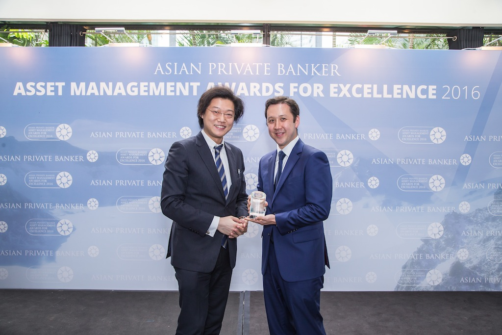 Alex Chambers from Man Group receives the award for Best Fund Provider - Japan Equity