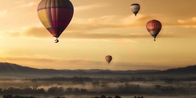 hot-air-balloon-valley-sky-99551