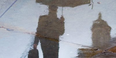 People move reflection rain